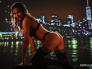 Fucking hot milf Tina Kay posing against the backdrop of the night city