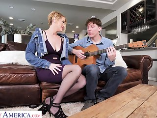 Young defy learns sexy milf how to play a guitar and she teaches him a true sex lesson